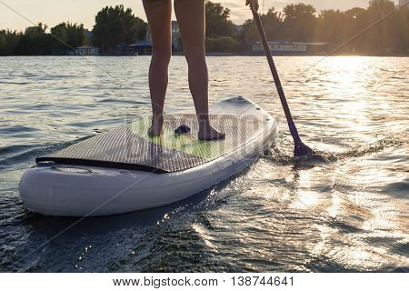 Sup Silhouette Of Young Girl Paddle Boarding At Sunset12