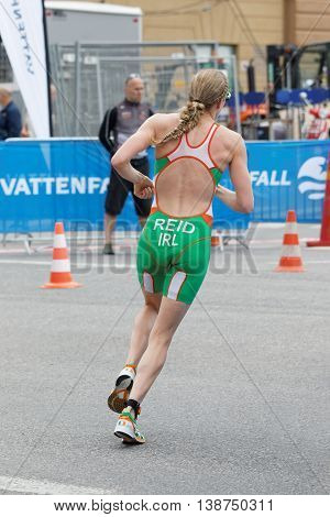 STOCKHOLM - JUL 02 2016: Triathlete Aileen Reid running in a curve rear view in the Women's ITU World Triathlon series event July 02 2016 in Stockholm Sweden