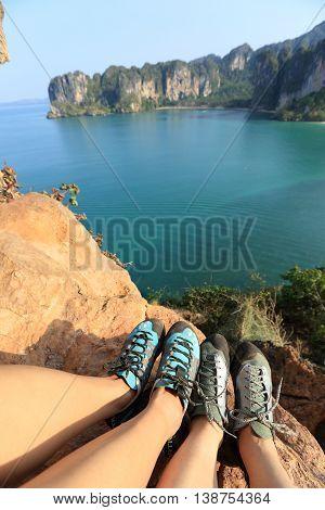 two rock climbers legs at seaside mountain rock