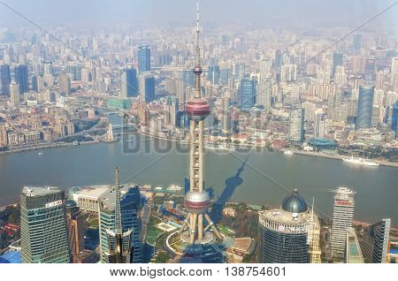 February 7 2016. Shanghai China. The Oriental Pearl Tower iconic landmark within Lujiazui Pudong new area of Shanghai China near the Huangpu River with pollution filled sky in the background..