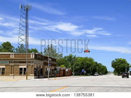 MOUND RIDGE, KANSAS, USA - MAY 17, 2015: Junction with a telegraph pole and traffic light hanging above the street.
