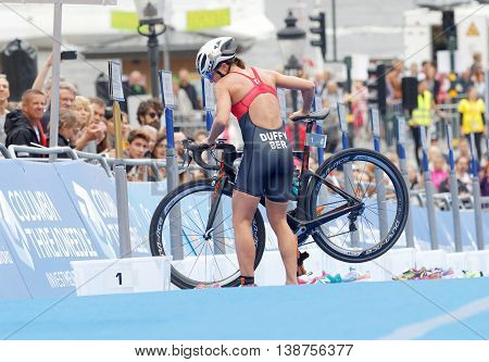 STOCKHOLM - JUL 02 2016: Leading triathlete Flora Duffy parking cycle in the transition zone in the transition zone in the Women's ITU World Triathlon series event July 02 2016 in Stockholm Sweden