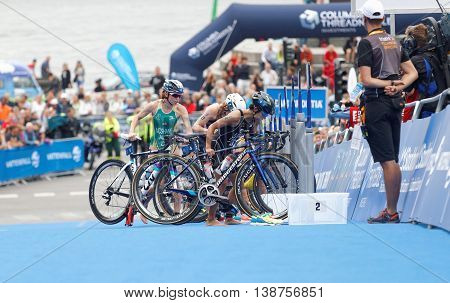 STOCKHOLM - JUL 02 2016: Group of triathletes parking cycles in the transition zone in the Women's ITU World Triathlon series event July 02 2016 in Stockholm Sweden