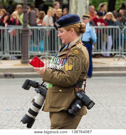 Paris France-July 14 2016 : The Australian military photographer during Bastille Day military parade on Champs Elysees avenue in Paris France.