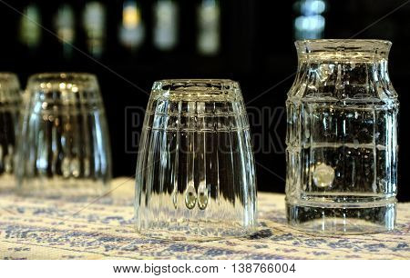 A set of glass beer mugs getting dried