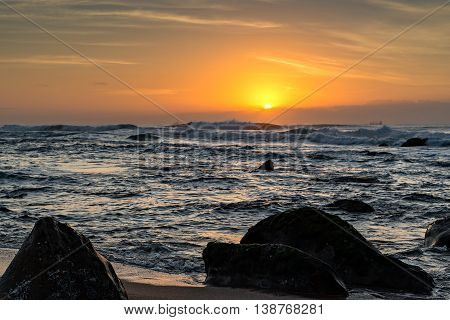 View of ships on the Indian Ocean from Umhlanga Rocks Beach at Sunrise