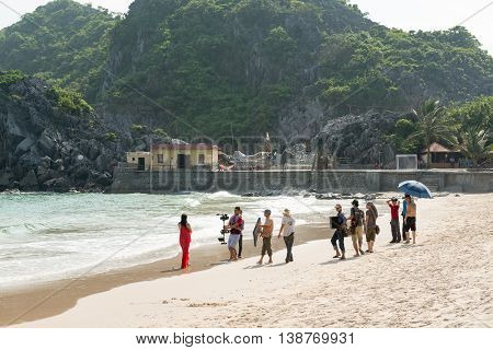 Cat Ba, Vietnam - May 12, 2014 - Vietnamese pop singer films music video at public beach at Cat Ba island