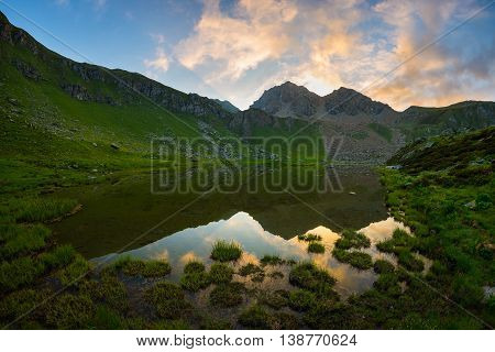 High Altitude Alpine Lake In Idyllic Land Once Covered By Glaciers. Majestic Rocky Mountain Peak Glo