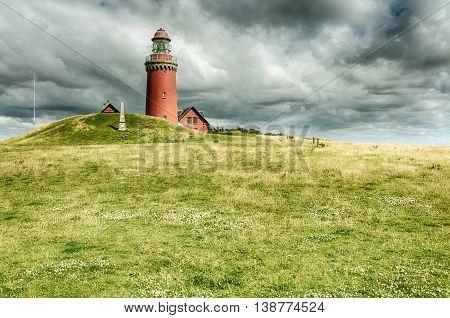 Danmark lighthouse on ameadow with cloudy sky