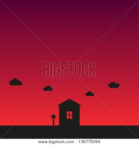 The house on sunset background The silhouette of small old house and the clouds in the sky at sunset