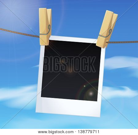 Photoframe on blue sky background and clothes pins. Vector illustration.