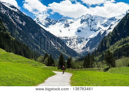 Beautiful scenery of Stiluptal on a sunny day with mountain peaks in the background.Stilluptal Austria Tyrol.