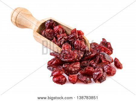dried cranberries in a wooden spoon on white