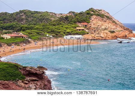 Pregonda Cove (Cala Pregonda) - lonely cove with rocks and red sand