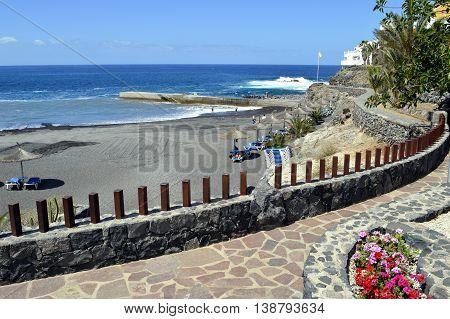 Callao Salvaje Tenerife Canary Islands Spain Europe - June 18 2016: Tourists on the volcanic sand on Playa de Ajabo beach