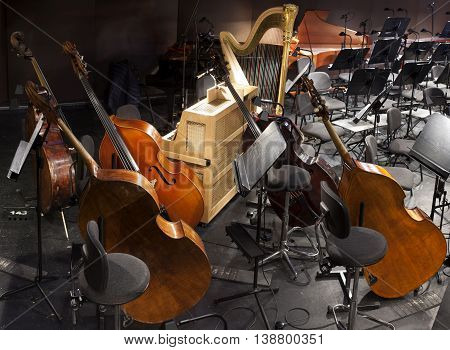 musical instruments on the stage and in the orchestra pit poster