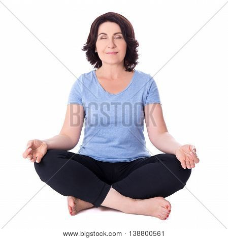 Mature Woman Sitting In Yoga Pose Isolated On White