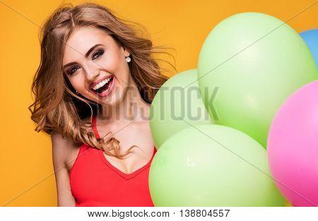 Girl With Balloons Posing In Studio.