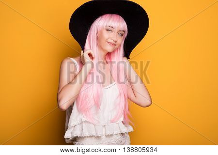Young Girl In Pink Hair Posing On Yellow Background.
