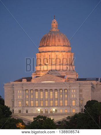 The lights come up as the sun fades on the capital building downtown Jefferson City Missouri