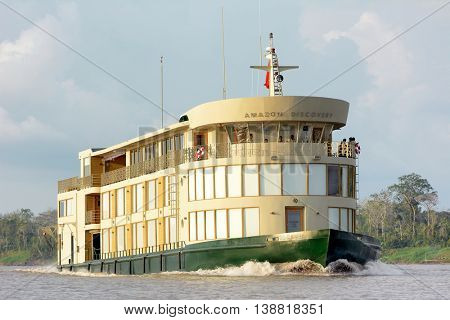 IQUITOS, PERU - OCTOBER 13, 2015: The Amazon Discovery river cruise ship. The luxury boat explores the rainforest and rivers of the Peruvian Amazon.