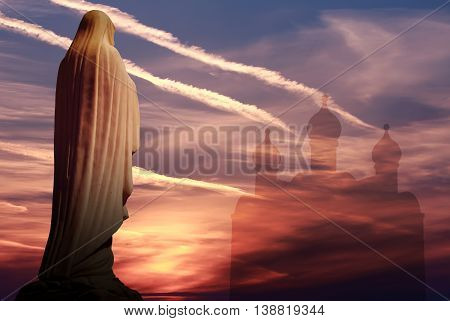 Mother of God over against dramatic sunset religious concept