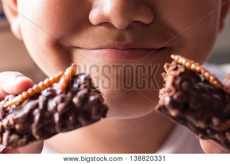 Children Eating Bamboo Worm Insect Crispy And Chocolate Wafer Bars Ingredients Include Almonds, Cash