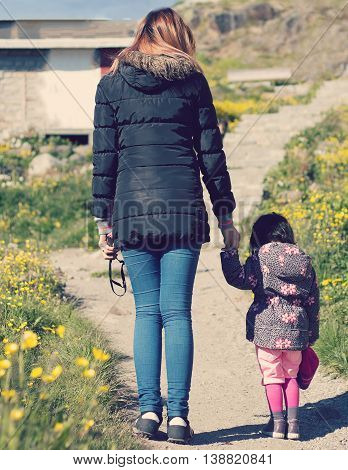 mother and 2 years kid walking with blue sky hold hand so happy and funny family