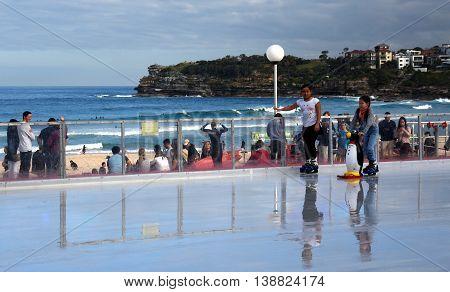 Sydney, Australia - Jul 17, 2016. Girls ice skating on Bondi ice rink. Australia's only beachside ice rink is on Bondi beach.