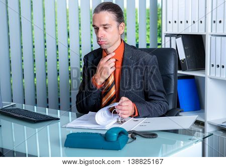 Business Man At His Desk In Summerly Hot Office