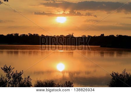 calm lake at sunset