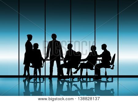 Silhouttes of business people as team sitting round table