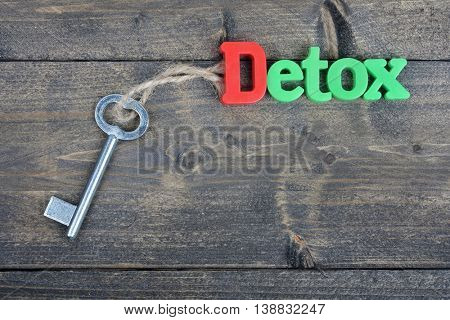 Detox word on wooden table