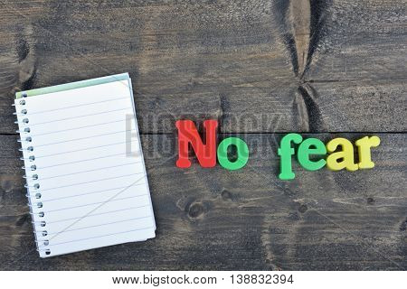 No fear word on wooden table