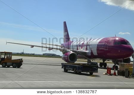 REYKJAVIK, ICELAND - JULY 6, 2016: Wow Air aircraft on tarmac at Keflavik International Airport. WOW air is an Icelandic low-cost carrier