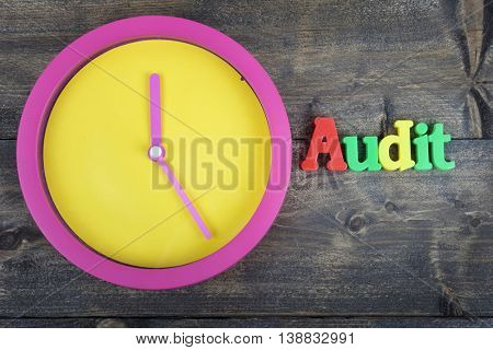Audit word on wooden table