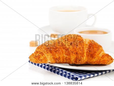 Breakfast with fresh croissants cup of coffee and honey on a white background