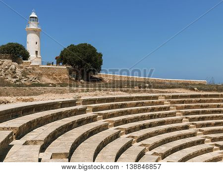 Ancient Odeon Amphitheatre with lighthouse in Paphos, Cyprus