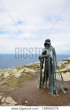 Tintagel Cornwall United Kingdom - July 01 2016: Gallo statue overlooking cornish coast at Tintagel. Inspired by Legend of King Arthur