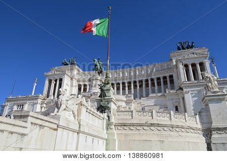 Italian flag at Altare della Patria the Monument to Victor Emmanuel II Rome.  Monumento Nazionale a Vittorio Emanuele II is a monument built in honor of the first king of unified Italy.