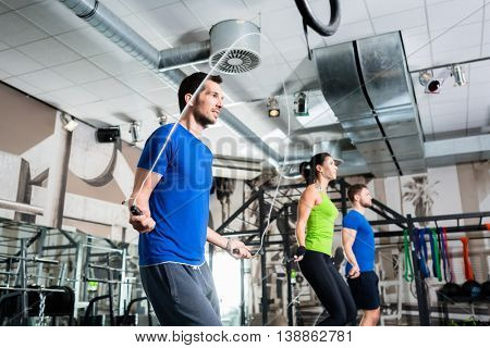 Group rope skipping in functional training gym as fitness exercise