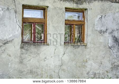 Two vintage wooden windows on an old farmhouse.