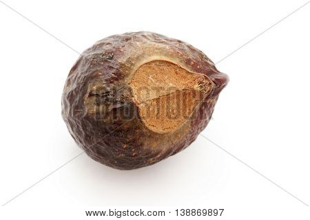 Organic Chinese soapberry or Reetha (Sapindus mukorossi) seed. Isolated on white background. Macro close up. Top view.