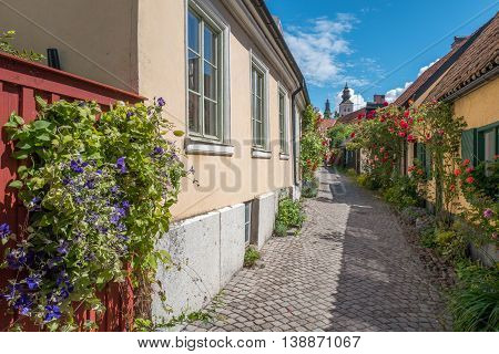 VISBY, SWEDEN - JULY 8, 2016: Medieval alley in Visby. Visby is a historic Hanse town and a major tourist destination on Swedish Baltic sea island Gotland.