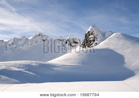 Mountain Peaks In Winter In Austrian Alps