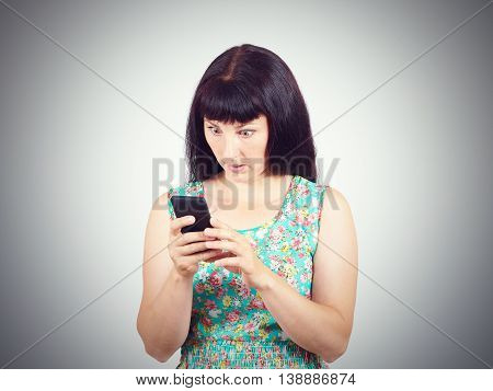 Young Woman Reads The Sms, The News On The Phone.