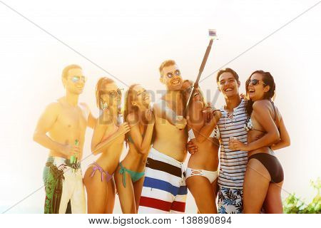 Group of people enjoying summer and taking a selfie