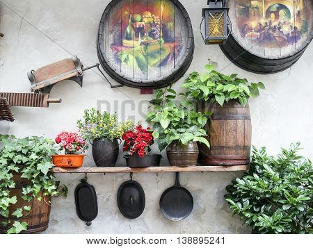 Rustic decoration on a wall with paintings flowers and vintage objects