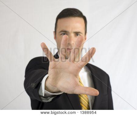 Businessman In Black Suit Shielding Face