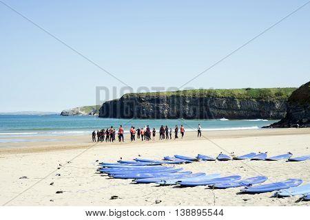 Ballybunion beach, Сounty Kerry, Ireland - July 1, 2014: people training at surf school on ballybunion beach in county kerry ireland